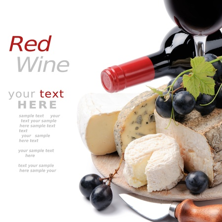 white wine bottle: Red wine with French cheese selection with copyspace over white Stock Photo