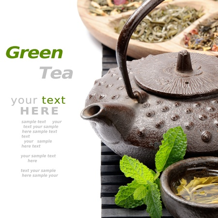 teapots: Asian teapot with green tea selection over white
