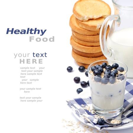 muesli: Healthy breakfast with yogurt, milk and blueberry Stock Photo