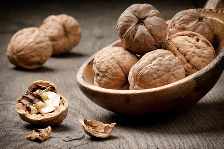 Still-life with walnuts on the old wooden table photo