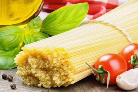 raw gold: Fresh ingredients for Italian pasta Stock Photo