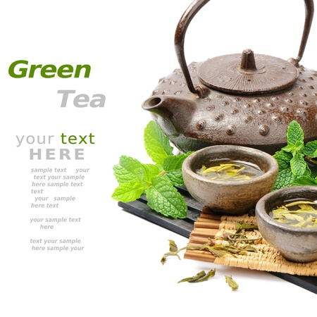 chinese tea pot: Asian tea set with dried green tea and fresh mint over white Stock Photo