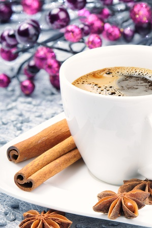 Christmas cup of coffee with festive background photo