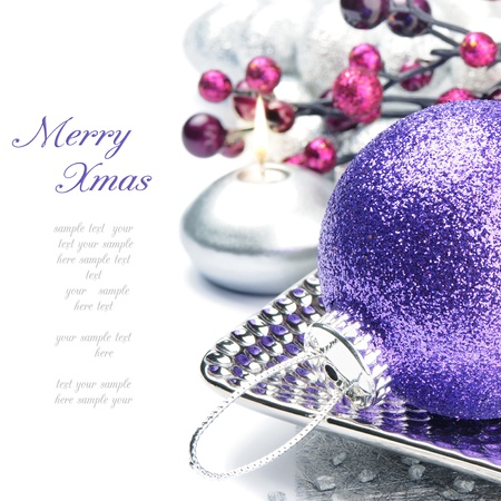 Purple Christmas ball on silver festive background photo