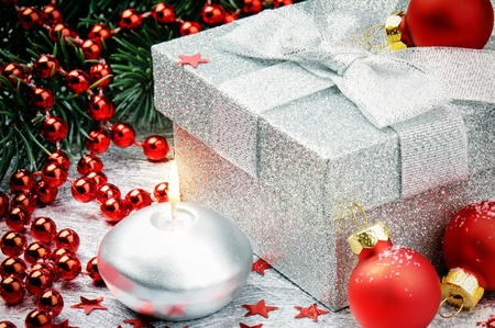 Christmas gift box with festive decoration in red tone photo