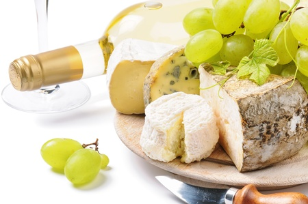 White wine with French cheese selection over white photo