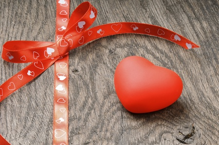 Red heart on old wooden table Stock Photo - 12429684