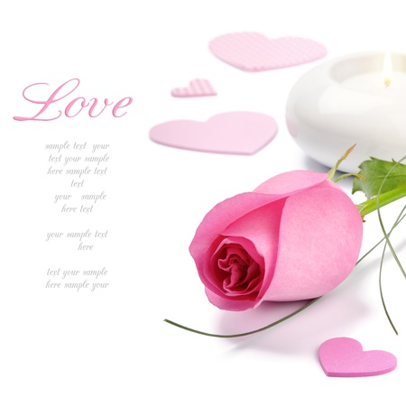 amour: Pink rose and candle over white Stock Photo