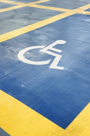 disabled parking sign: Parking space reserved for handicapped person.After rain Stock Photo