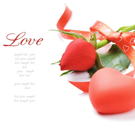 Red rose and heart-shaped decoration over white photo