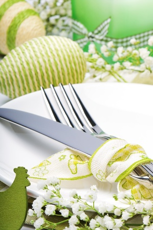 paschal: Easter table setting with candle and flowers Stock Photo