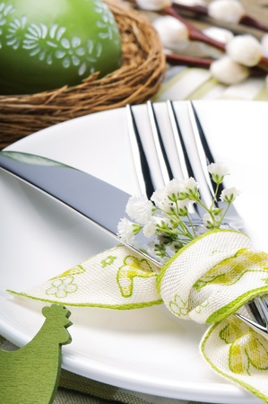 Easter table setting with flowers photo