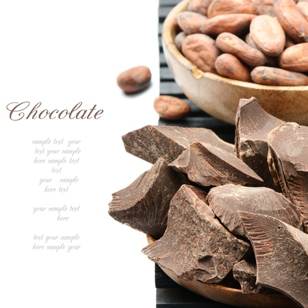 Crushed dark chocolate with cocoa beans over white photo