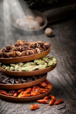 Colorful mix of spices on old wooden table photo