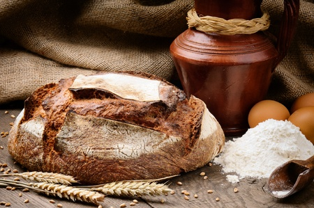 Freshly baked traditional bread in a countryside setting Stock Photo - 12760118