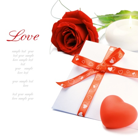 Red rose and envelope in romantic set over white photo