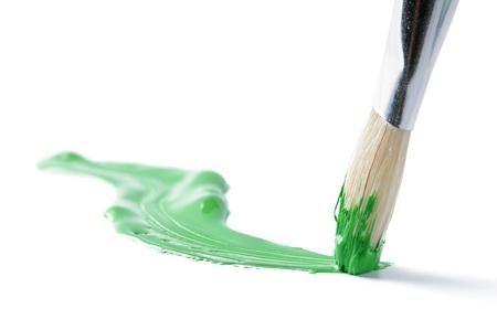 paint brush: Artist brush and hand drawn green line over white Stock Photo