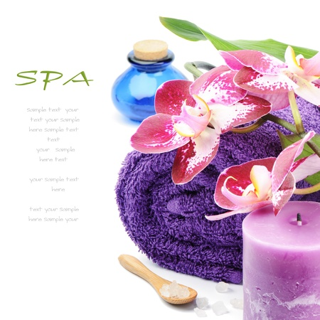 alternative wellness: Spa setting in purple tone over white Stock Photo