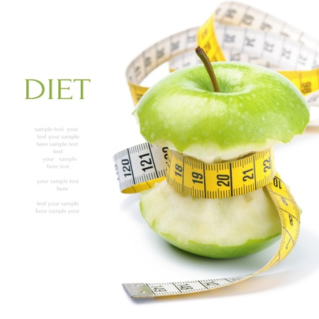 weight control: Green apple core and measuring tape. Diet concept Stock Photo