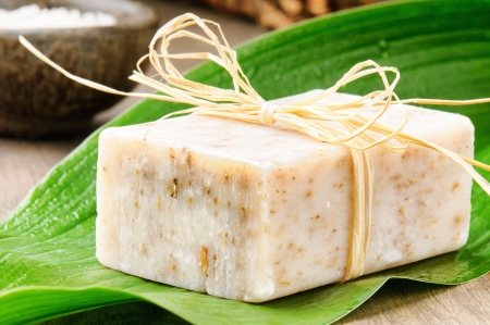 Natural handmade soap on a fresh green leaf photo