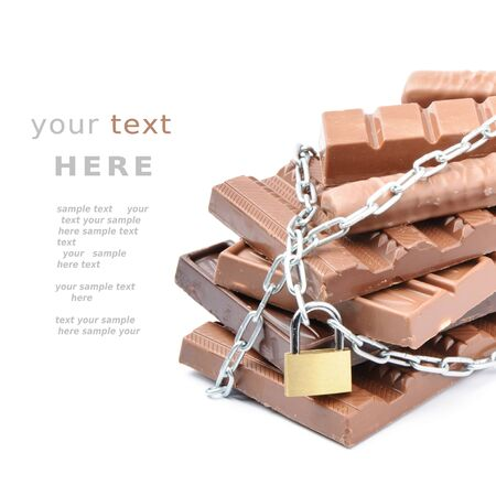 locked: Chocolate bars tied up with chains. Diet concept Stock Photo
