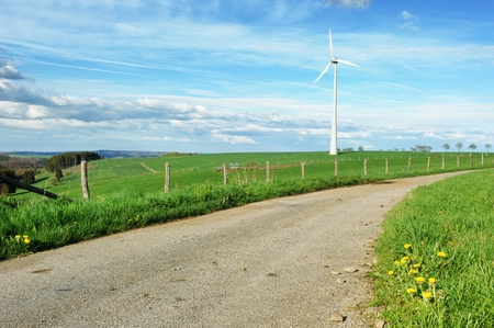 Eco landscape with country road and lonely wind turbine Stock Photo - 13758540