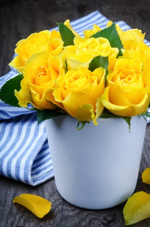 Beautiful yellow roses in a ceramic vase