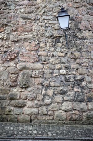 Old stone wall with lantern Background concept photo