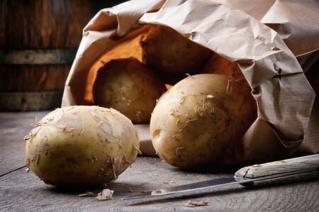 New potatoes in a brown paper bag photo