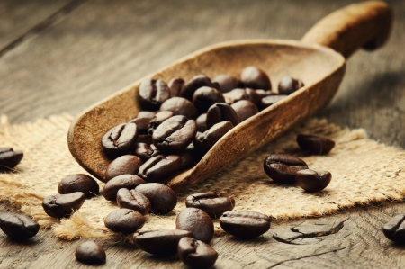 cocoa bean: Coffee beans in an old wooden scoop Stock Photo