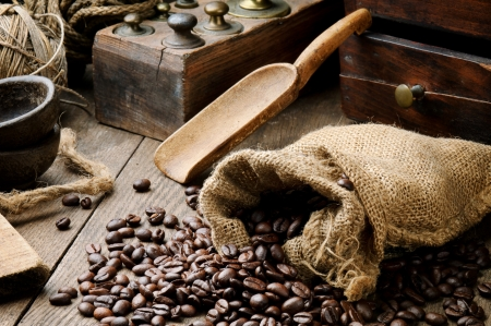 Roasted coffee beans and brass weights in vintage setting photo