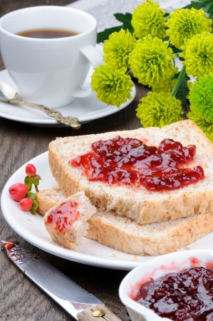 jam sandwich: Breakfast with toasts, coffee and summer flowers