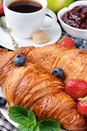Breakfast with coffee, croissants and fresh  berries photo