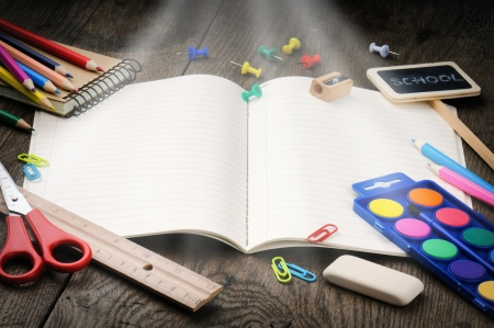 secondary education: School notebook with magic light. Education concept