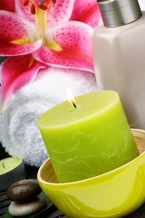 Spa setting with candle and pink lily photo