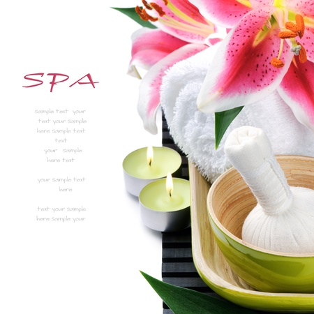 pink lily: Spa setting with candles and pink lily isolated on white