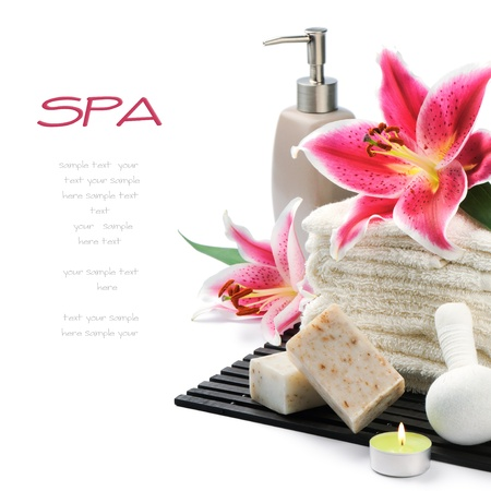 spa candles: Spa setting with towels, organic soap and lily isolated on white