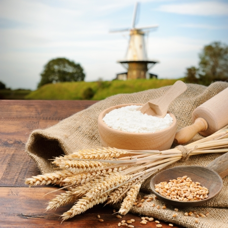 flour mill: Organic ingredients for bread preparation on old wooden table Stock Photo
