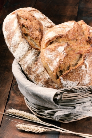 Freshly baked traditional bread in the basket photo