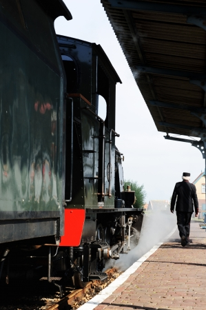 baggage train: Historical steam train locomotive at station