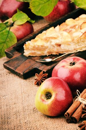 Piece of homemade apple pie in vintage setting photo