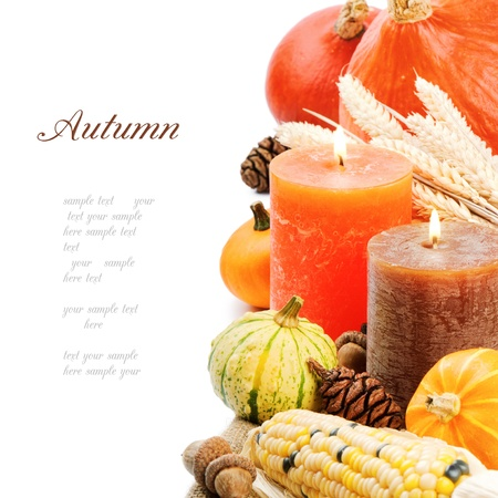pumpkin border: Autumn setting with candles and pumpkins isolated on white Stock Photo