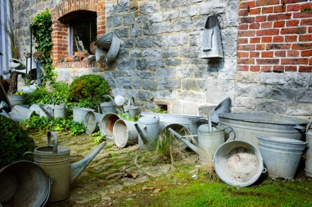 old farm: Vintage backyard with gardening tools at sunny day