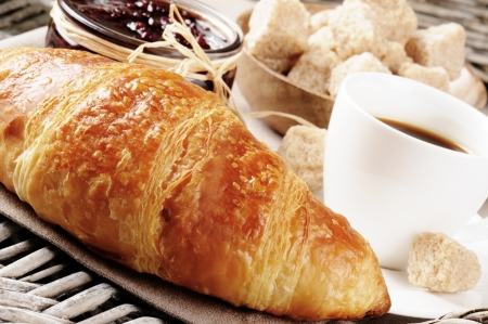 Breakfast with coffee, French croissant and jam on wicker tray Stock Photo - 15816317