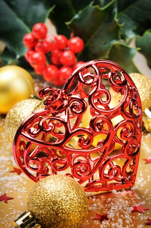 Heart shaped Christmas decoration on golden background photo