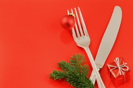 Christmas menu & invitation concept over red background photo