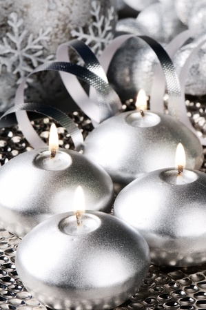 Christmas candles with festive decoration in silver tone photo