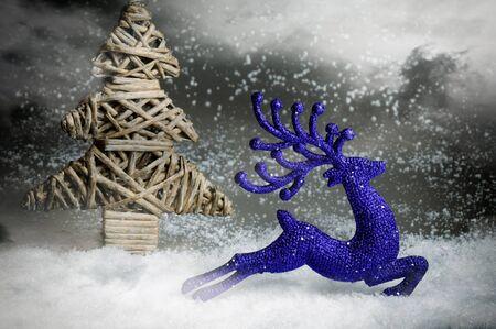 running reindeer: Christmas deer running in snowing magic forest Stock Photo