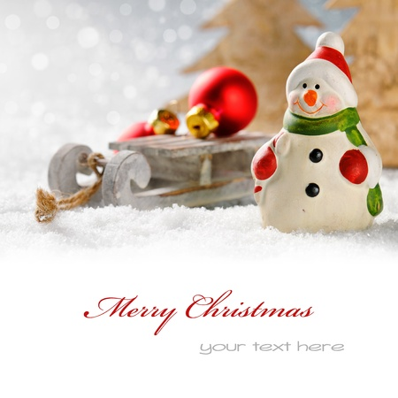 Christmas snowman with presents in winter forest with copyspace Stock Photo
