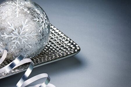 Festive Christmas decoration over silver background with copyspace photo